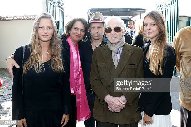Daughter of Pierre Huth Nathalie HuthGuizol with her daughters Alice and Claire Guizol and Singer Charles Aznavour with his son Mischa Aznavour...