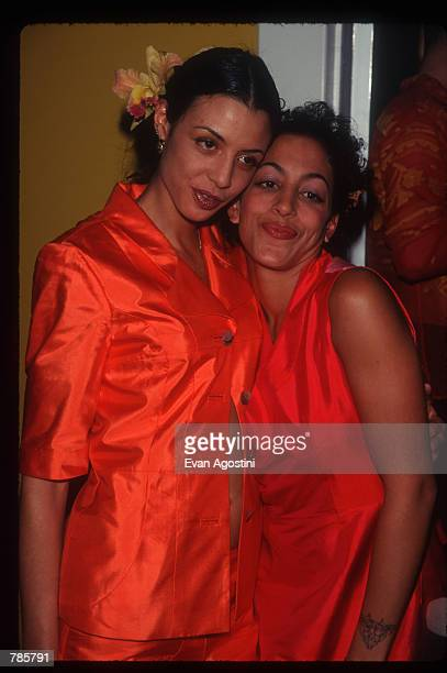 "Daughter of Robert De Niro Drena De Niro stands with Gregory Hines'' daughter Daria Hines at the ""Alpana Bawa"" boutique in SoHo December 12, 1996 in..."