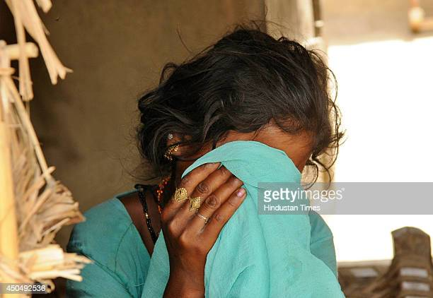 Daughter of the brotherinlaw of deceased woman cries as his father was also named among accused on June 12 2014 in Bahraich India Seminude body of...