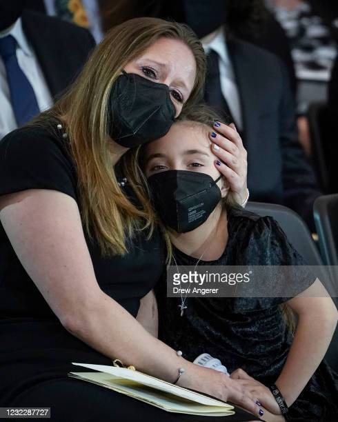 """Daughter of the late U.S. Capitol Police officer William """"Billy"""" Evans, Abigail, is comforted by her mother ShannonTerranova during a memorial..."""