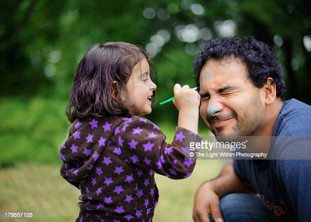 daughter paints daddy's face - face paint stock pictures, royalty-free photos & images