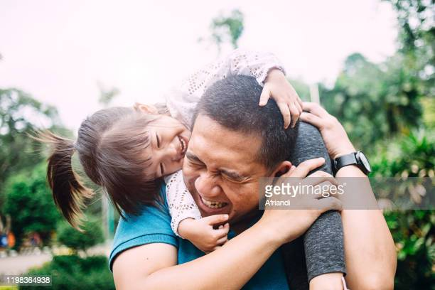 daughter playing with her father - carrying on shoulders stock pictures, royalty-free photos & images