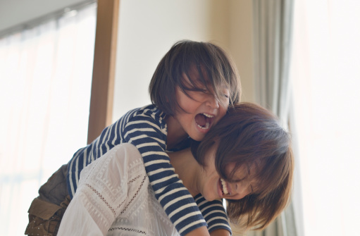 Daughter playing with Mother in the room - gettyimageskorea