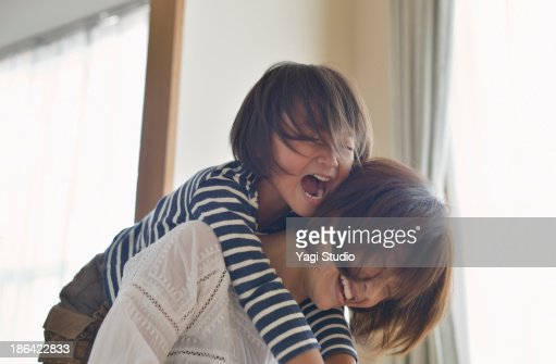 Daughter playing with Mother in the room
