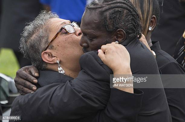 Daughter Sharon Risher and Gary L Washington son of Emanuel AME Church shooting victim Ethel Lance hug after Lance's burial at the Emanuel AME Church...
