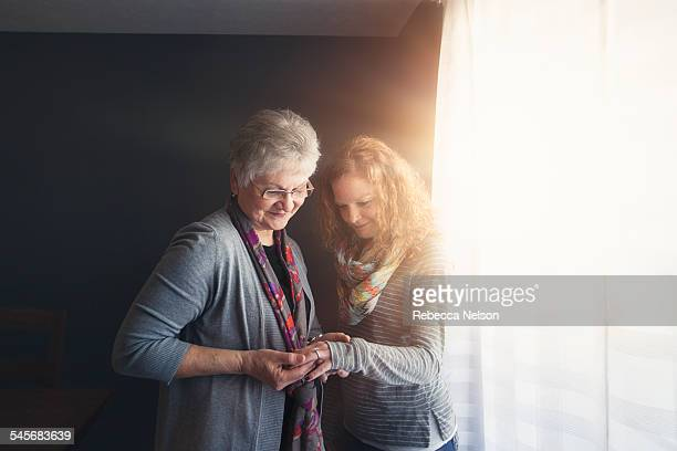 daughter showing mom her engagement ring - wide angle stock pictures, royalty-free photos & images