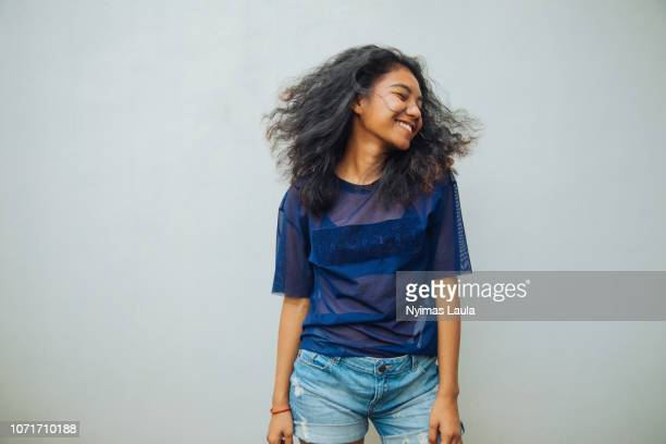 portrait of a young indonesian woman smiling. - showus stock-fotos und bilder