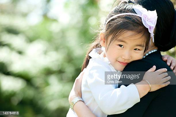 daughter smiling - 一張羅 ストックフォトと画像