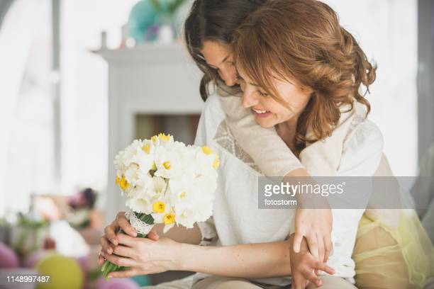 daughter surprising her mother with daffodils - tulips and daffodils stock pictures, royalty-free photos & images