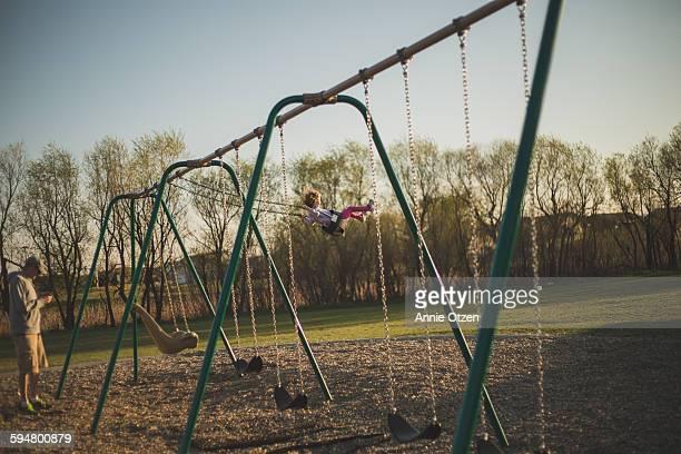 Daughter swing on swing