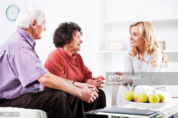 Daughter talking to her elderly parents