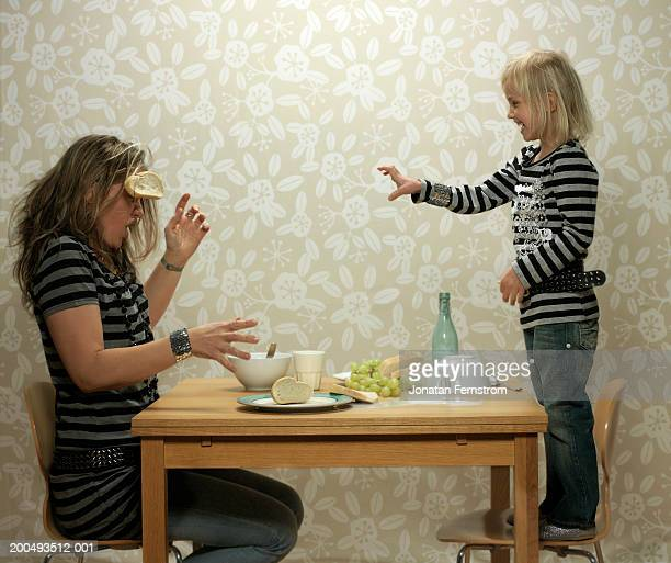 Daughter (4-5) throwing food at mother during meal