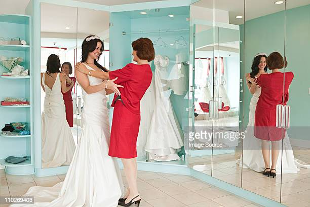 daughter trying on wedding dress and tiara with mother - wedding dress stock pictures, royalty-free photos & images