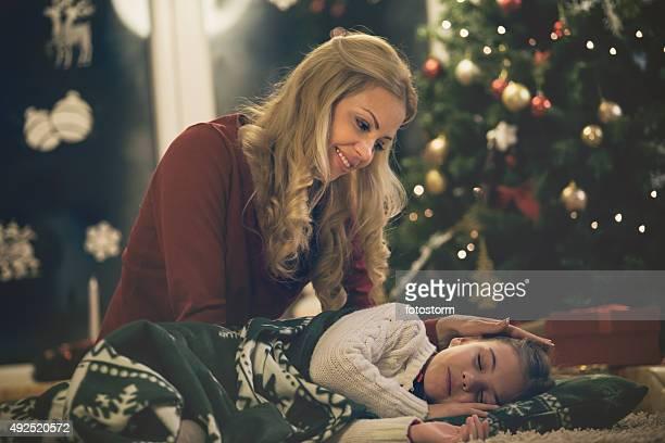 Daughter waiting for Santa, sleeping on the floor