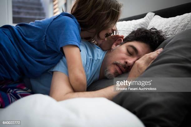 Daughter waking dad