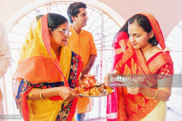 Daughter-In-Law Placing some Cash on the Pooja Thali for Prayers