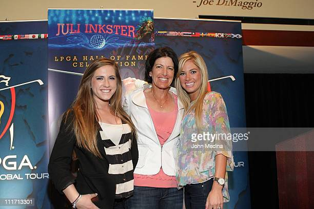 Daughters Cori Inkster and Hayley Inkster pose for a photo with mom Juli Inkster during Juli Inkster's LPGA Hall Of Fame celebration at ATT Park on...