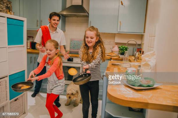 daughters flipping pancakes! - pancake day stock pictures, royalty-free photos & images