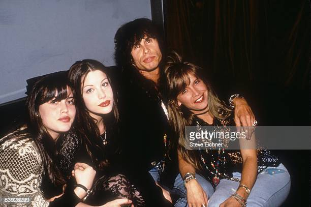 Daughters Mia and Liv father Steven and wife Teresa Barrick find some down time at Club USA in New York 1993