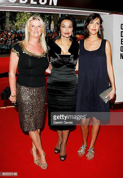 Daughters of actor Michael Caine, Dominique Caine and Natasha Caine and his wife Shakira Baksh, arrive at the European film premiere of 'The Dark...