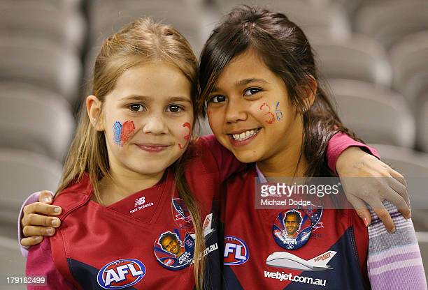 Daughters of Demons player Aaron Davey Mikayla Davey and Atalia Davey show their support during the round 23 AFL match between the Western Bulldogs...