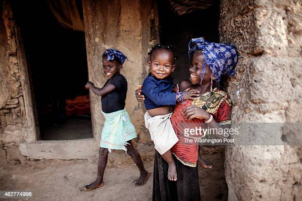 Daughters of Etienne Ouamouno Marie Kane and Seyou 7 outside of their home in Meliandou Guinea on January 25 2015 Meliandou is considered the...