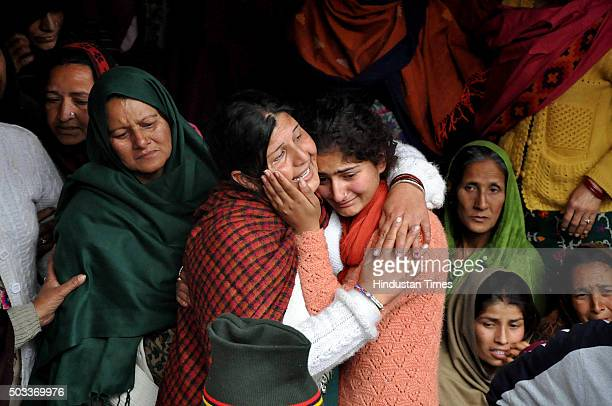 Daughters of martyr Sanjeevan Singh Rana who was killed in terrorist attack in Pathankot wail near his body during his funeral at his native village...