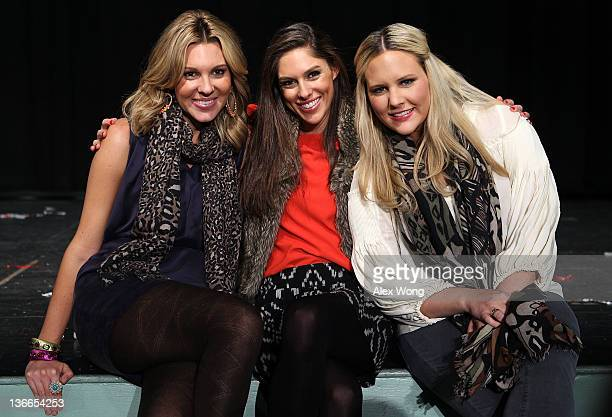 Daughters of Republican presidential candidate and former Utah Gov. Jon Huntsman, Mary Anne, Abby and Liddy, pose for photographers after a...