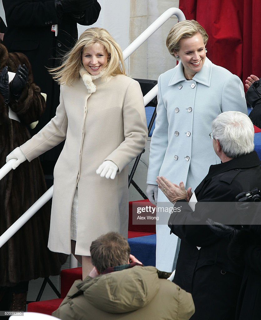 Daughters of U.S. Vice President Dick Cheney, Liz (L) and Mary (R) arrive on the inaugural platform before the start of the swearing-in ceremony for U.S. President George W. Bush January 20, 2005 in Washington, DC. In his inaugural address, President Bush outlined his plans to pursue freedom around the world as well as push a legacy-setting agenda at home championing 'freedom in all the world' as the surest path to peace.