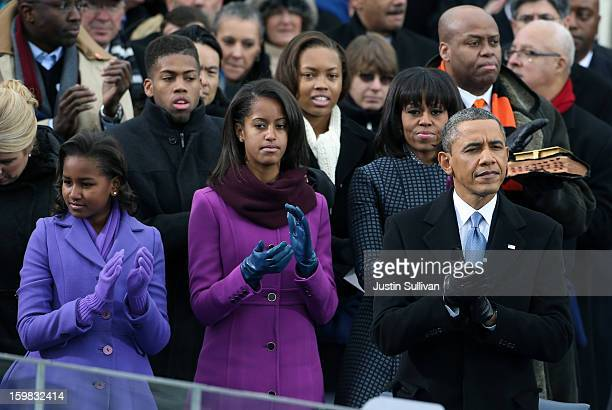 Daughters Sasha Obama and Malia Obama First lady Michelle Obama and US President Barack Obama clap during the presidential inauguration on the West...