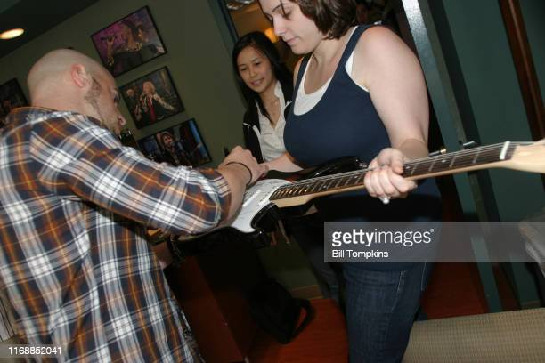 Daughtry appears on the TV show PRIVATE SESSIONS on July 19 2009 in New York City Members of the band autograph guitars and posters
