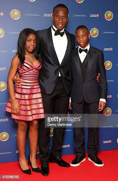 Daugter Iman Drogba Didier Drogba and son Isaac Drogba attends the Didier Drogba foundation charity ball at The Dorchester on April 18 2015 in London...