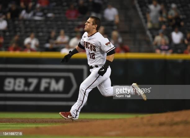 Daulton Varsho of the Arizona Diamondbacks runs to third base after hitting a triple against the Atlanta Braves during the third inning at Chase...