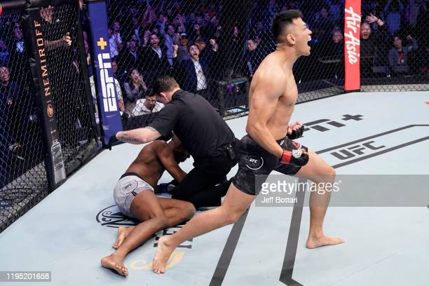 Daun Jung of South Korea celebrates after knocking out Mike Rodriguez in their light heavyweight fight during the UFC Fight Night event at Sajik...