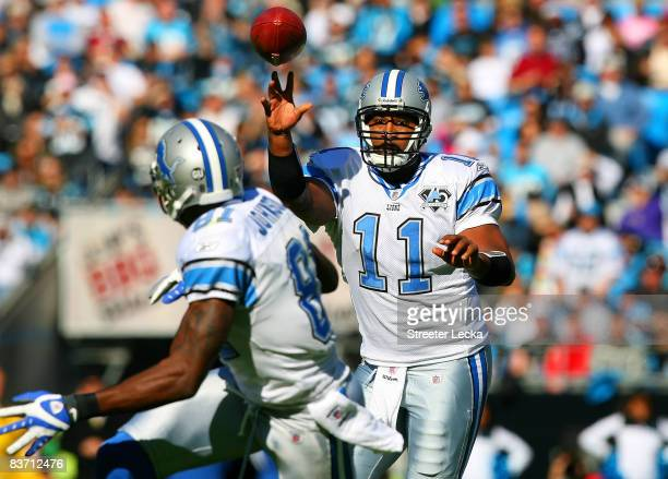 Daunte Culpepper of the Detroit Lions throws a pass to teammate Calvin Johnson during their game against the Carolina Panthers at Bank of America...