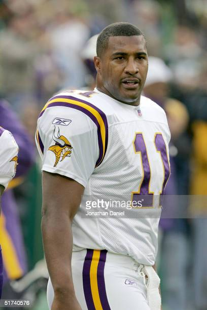 Daunte Culpepper of the Minnesota Vikings stands on the sidelines during a game against the Green Bay Packers at Lambeau Field on November 14 2004 in...