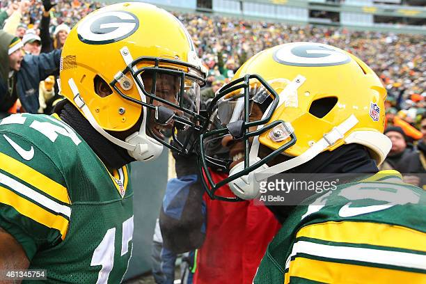 Davante Adams and Randall Cobb of the Green Bay Packers celebrate after Adams scored against the Green Bay Packers in the third quarter of the 2015...