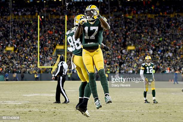 Davante Adams and Ty Montgomery of the Green Bay Packers celebrate after scoring a touchdown in the second quarter during the NFC Wild Card game...
