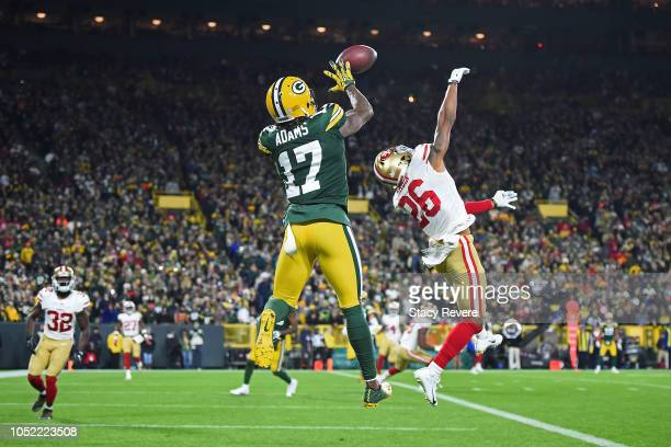 Davante Adams of the Green Bay Packers catches a pass for a touchdown in front of Greg Mabin of the San Francisco 49ers during the second half at...