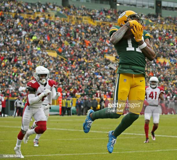 Davante Adams of the Green Bay Packers catches a pass for a touchdown during the first half of a game against the Arizona Cardinals at Lambeau Field...