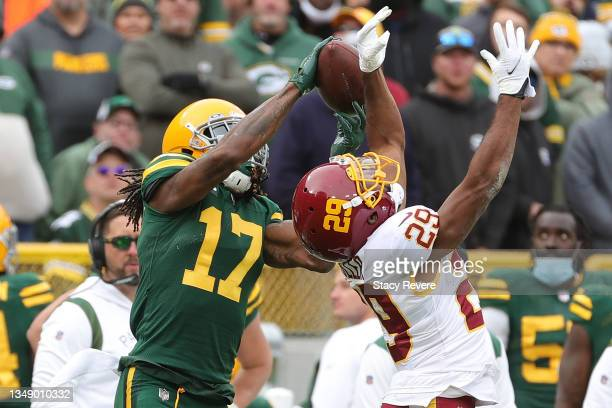 Davante Adams of the Green Bay Packers catches a pass in front of Kendall Fuller of the Washington Football Team during a game at Lambeau Field on...