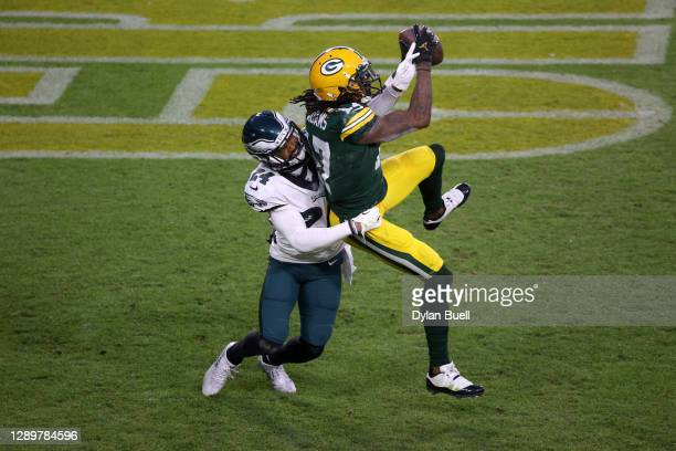 Davante Adams of the Green Bay Packers catches a touchdown pass against Darius Slay of the Philadelphia Eagles during the first quarter of their game...