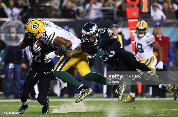 Davante Adams of the Green Bay Packers catches a touchdown pass against Leodis McKelvin and Rodney McLeod of the Philadelphia Eagles in the first...