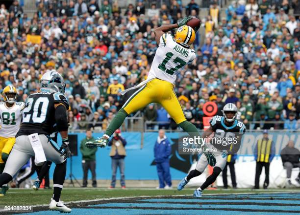 Davante Adams of the Green Bay Packers catches a touchdown pass against the Carolina Panthers in the first quarter during their game at Bank of...