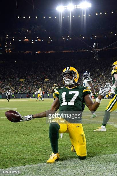 Davante Adams of the Green Bay Packers celebrates after running in a 40yard touchdown catch against the Seattle Seahawks in the third quarter of the...