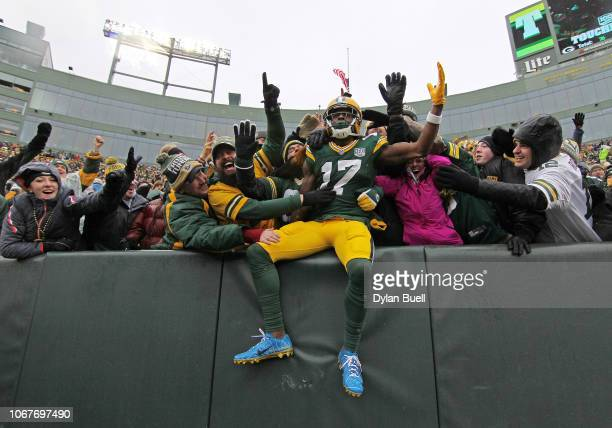 Davante Adams of the Green Bay Packers celebrates with fans after scoring a touchdown during the first half of a game against the Arizona Cardinals...
