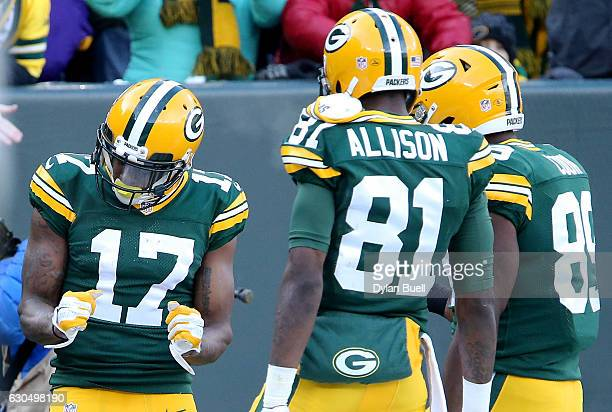 Davante Adams of the Green Bay Packers celebrates with Geronimo Allison and Jared Cook after scoring a touchdown in the first quarter against the...