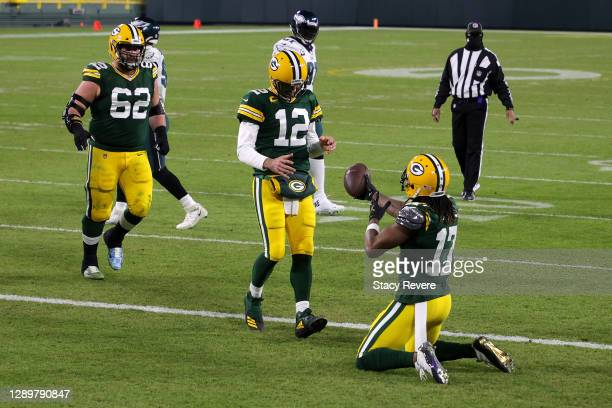 Davante Adams of the Green Bay Packers celebrates with teammate Aaron Rodgers following a nine yard touchdown reception during the third quarter of...