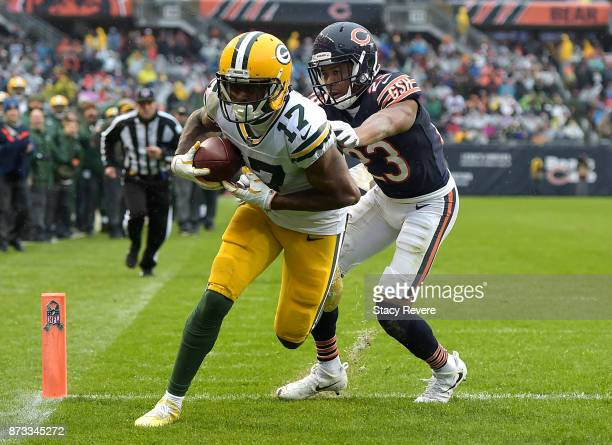 Davante Adams of the Green Bay Packers completes the pass against Kyle Fuller of the Chicago Bears for a touchdown in the fourth quarter at Soldier...