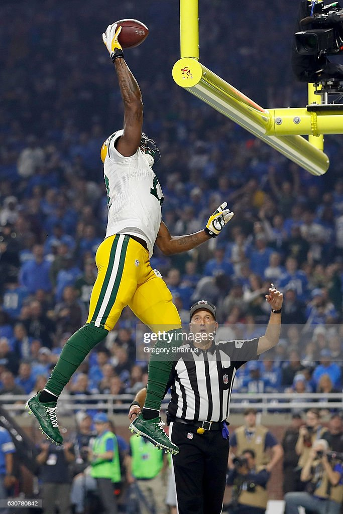 Davante Adams #17 of the Green Bay Packers gets ready to spike the ball over the goal post after scoring a touchdown during third quarter action against the Detroit Lions at Ford Field on January 1, 2017 in Detroit, Michigan. Adams was given a penalty for the spike of the ball.